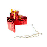 Greeting card Christmas beads on the  two gifts Royalty Free Stock Photo