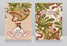 Greeting card with christmas bells and mistletoe Stock Photo