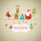 Greeting card, Christmas card. With Santa Claus ,deer and little bird Royalty Free Stock Photography