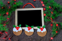 Greeting card christmas decoration pudding from felt with red stars and black chalkboard Royalty Free Stock Images