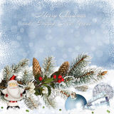 Greeting card with Christmas decorations and pine branches on snowy background Stock Photo