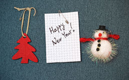 Greeting card and Christmas decorations, pinned on a blue backgr Stock Photography