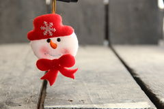 Greeting card for Christmas and New Year. Snowman toy. Stock Image