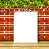 Greeting card with christmas tree branches, garlands and brick wall Stock Photography