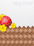 Easter Card. Greeting card with a colored egg (red) and flowers (narcussus and daisies Royalty Free Stock Photo