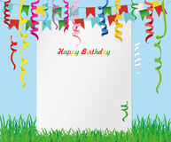 Greeting card with colorful flags and confetti on green grass. Stock Photos