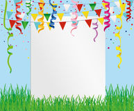 Greeting card with colorful flags and confetti on green grass. Stock Images