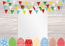 Greeting card with colorful flags and easter eggs. Free form for. Text or advertising. Vector on wooden background. Invitation to the holiday Royalty Free Stock Images