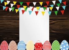 Greeting card with colorful flags and easter eggs. Free form for. Text or advertising. Vector on wooden background. Invitation to the holiday Royalty Free Stock Photography