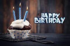 Greeting card with cupcake Stock Photos