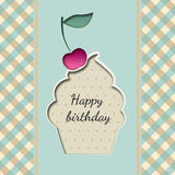 Greeting card with a cupcake birthday with a cherry Royalty Free Stock Photography