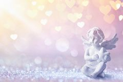 Greeting Card With Cupid On Shiny Background Stock Photography