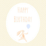 Greeting card with cute bunny. The bunny is holding a balloon. Background of polka dots Stock Photography