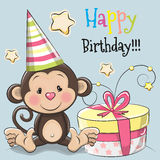 Greeting card cute monkey with gift Stock Images