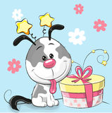 Greeting card cute Puppy with gift. On a pink background Royalty Free Stock Photo