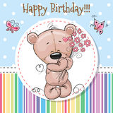 Greeting card Cute Teddy Bear. With a flower Royalty Free Stock Images