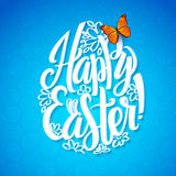 Greeting card for the day of Happy Easter. White Calligraphy letters on a blue background with butterfly. Egg shape Royalty Free Stock Image