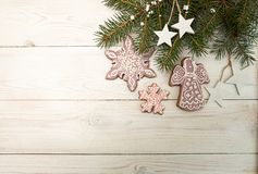 Greeting card with decor gingerbread cookies snowflakes, fir tre Stock Photography