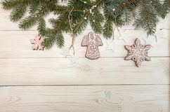Greeting card with decor gingerbread cookies snowflakes, fir tre Royalty Free Stock Images