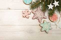 Greeting card with decor gingerbread cookies snowflakes, fir tre Royalty Free Stock Photo