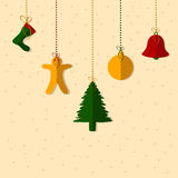 Greeting card decorated with haging Christmas objects. Stock Images