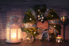 Greeting card design with decorative lantern and Christmas wreat. Greeting card design with decorative lantern, candles and Christmas wreath with decorations on Stock Image
