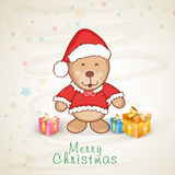 Greeting card design for Merry Christmas celebration. Cute teddy bear in Santa dress with gift boxes for Merry Christmas celebration Royalty Free Stock Image