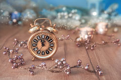 Greeting card design with vintage clock showing five to mignight Stock Image