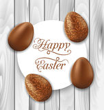Greeting card with Easter chocolate ornamental eggs on wooden ba Royalty Free Stock Photo
