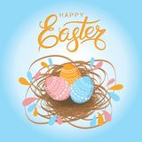 Greeting card for Easter. Hand drawn lettering text `Happy Easter` on blue background Stock Photos