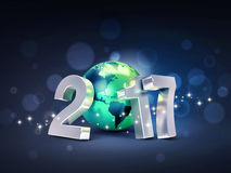 2017 Greeting card for environment. 2017 New Year type composed with a green planet earth, on a glittering black background - 3D illustration Royalty Free Stock Photography