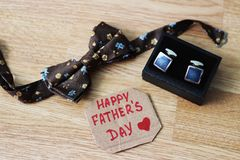 Greeting card with Father`s Day. View from above. Fathers day composition on wooden desk backround. stock photos