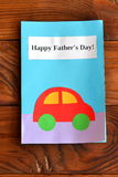 Greeting card father's day on a wooden desk. Happy father's day. Kids crafts Stock Photo