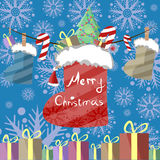 Greeting card with a festive garland of lights, red hats and Christmas boots, which are gifts, candy and decorated Christmas tree. Royalty Free Stock Photography