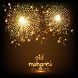 Greeting card with firecrackers for Eid Mubarak. Royalty Free Stock Photo