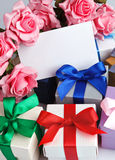Greeting card with flowers and gifts Royalty Free Stock Photo