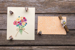 Greeting card with flowers on wooden background. Royalty Free Stock Images