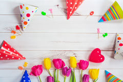 Free Greeting Card For Princess Girl. Tulips, Party Hat, Candle, Red Stock Photos - 68084753