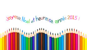 Greeting card with french text meaning happy new year 2015 greeting card, colorful pencils Royalty Free Stock Image