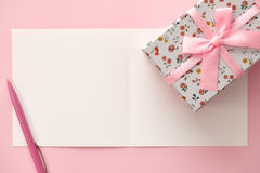 Greeting card, gift box and pen in pink colors Royalty Free Stock Photo