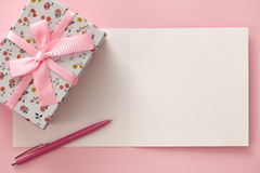 Greeting card, gift box and pen in pink colors Royalty Free Stock Photos