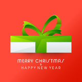 Greeting card with gift for Christmas and New Year. Royalty Free Stock Image