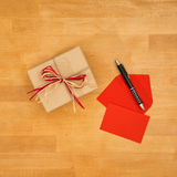 Greeting card and gift, high angle view Royalty Free Stock Photos