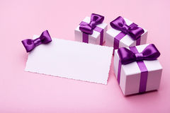 Greeting card and gift on pink Stock Photography