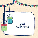 Greeting card with gifts for Eid festival celebration. Royalty Free Stock Photos