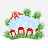 Greeting-card and gifts on the green branches of christmas tree Royalty Free Stock Images
