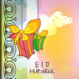 Greeting card with gifts for Islamic festival, Eid. Stock Photos