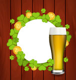 Greeting card with glass of light beer, shamrocks Stock Photos