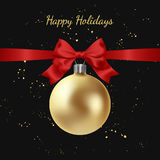 Greeting card with golden Christmas ball and red bow Stock Photos