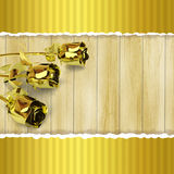 Greeting card with golden roses on wooden background Stock Photo
